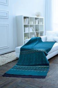 Koc w kolorze turkusowym